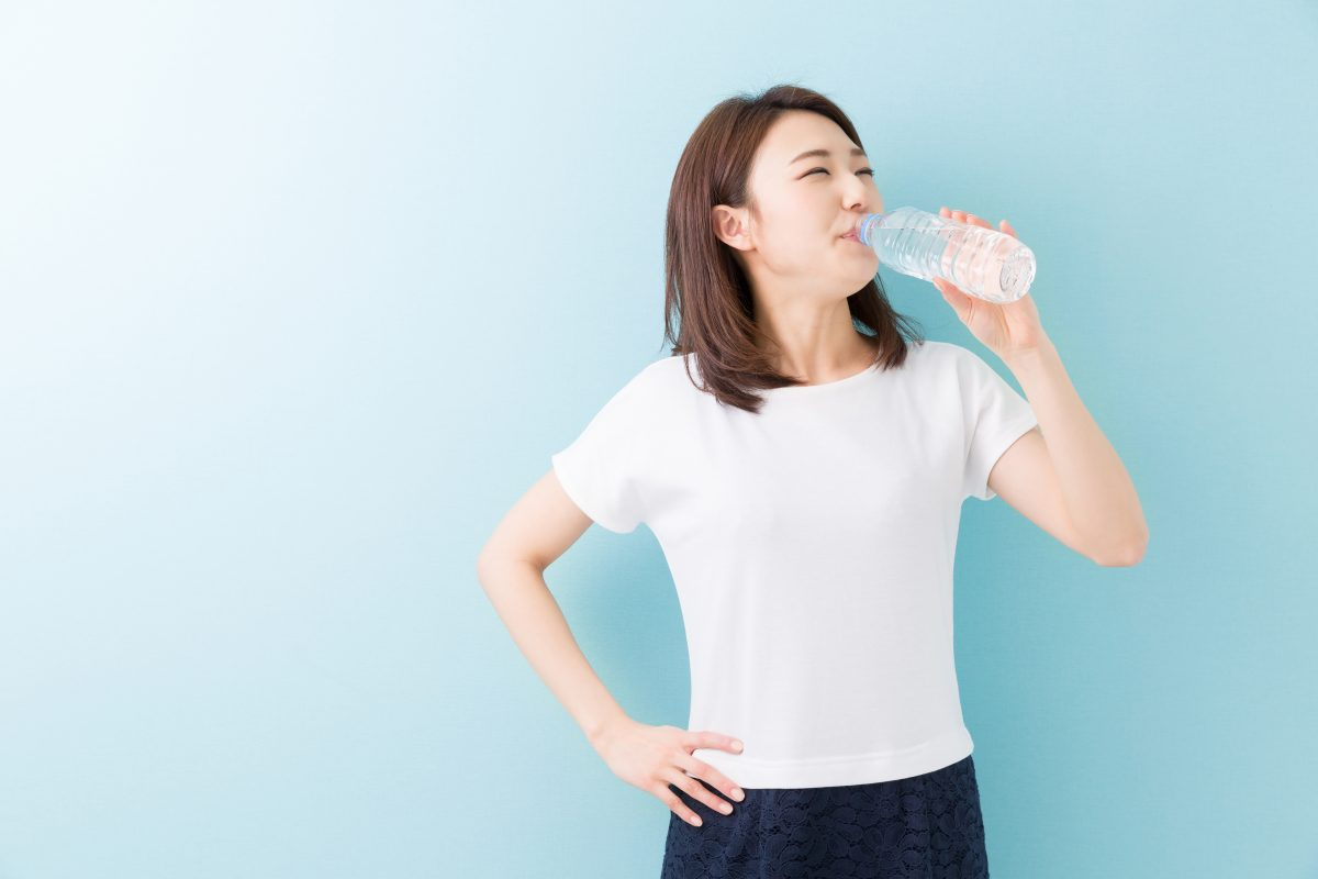 Japanese woman drinking water bottle